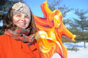 Angela Stelljes, a Greater Greenwood Arts Council board member, is seen with a sculpture along Polk Hill Trail. Rob Goebel / The Star