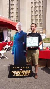 Student stands next to Glenn Close cut-out